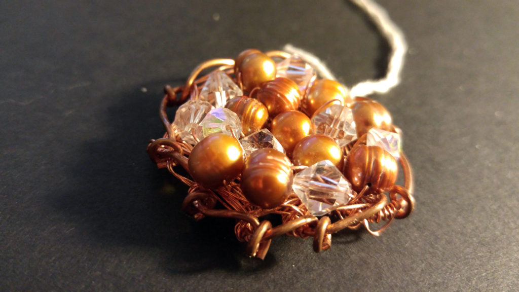 Front Fresh Water Pearls, Swarovski Crystals on a Copper Wire woven pendant.